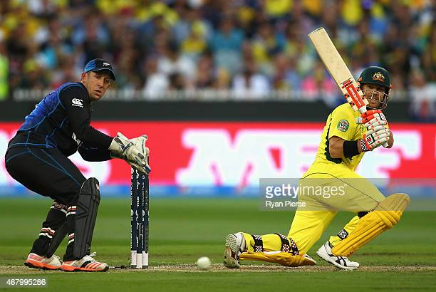 David Warner of Australia bats as Luke Ronchi of New Zealand keeps wicket during the 2015 ICC Cricket World Cup final match between Australia and New...
