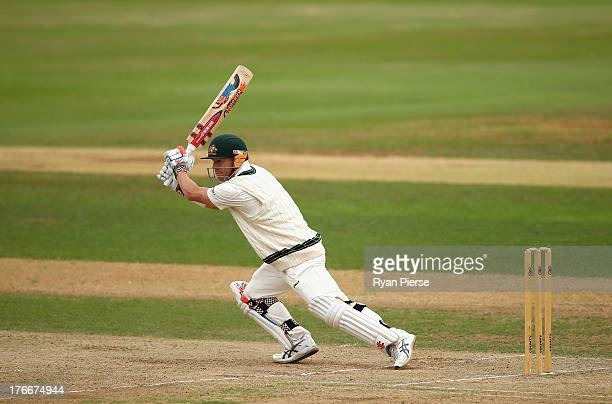 David Warner of Australia bats during day two of the Tour Match between England Lions and Australia at The County Ground on August 17 2013 in...