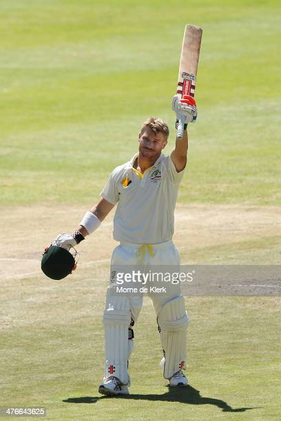David Warner of Australia celebrates after reaching 100 runs during day 4 of the third test match between South Africa and Australia at Sahara Park...