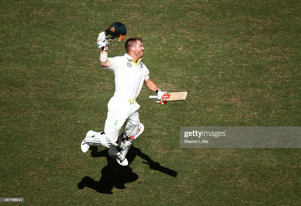 David Warner of Australia celebrates after reaching his century during day three of the First Test between Pakistan and Australia at Dubai...