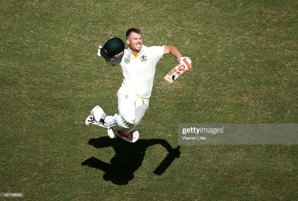 David Warner of Australia celebrates after reaching his century during day three of the First Test between Pakistan and Australia at Dubai International Stadium at Dubai International Stadium on October 24, 2014 in Dubai, United Arab Emirates.