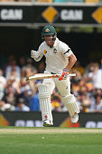 David Warner of Australia celebrates after reaching his century during day one of the First Test match between Australia and New Zealand at The Gabba...