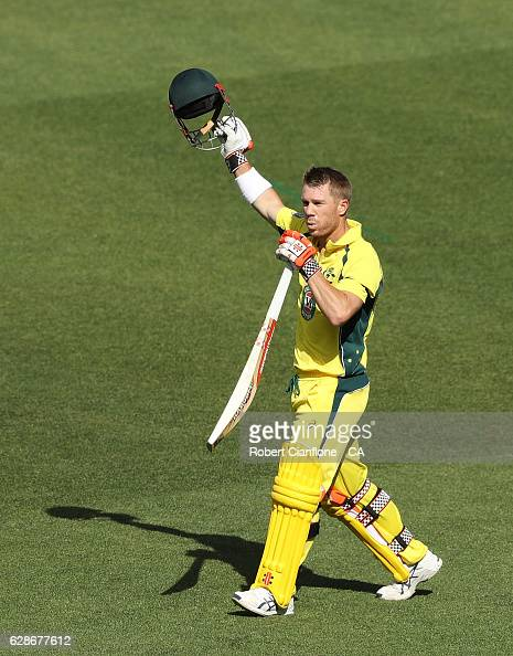 David Warner of Australia celebrates after reaching his century during game three of the One Day International series between Australia and New...