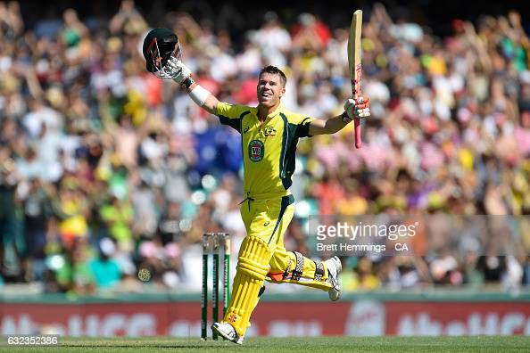 David Warner of Australia celebrates after scoring a century during game four of the One Day International series between Australia and Pakistan at...