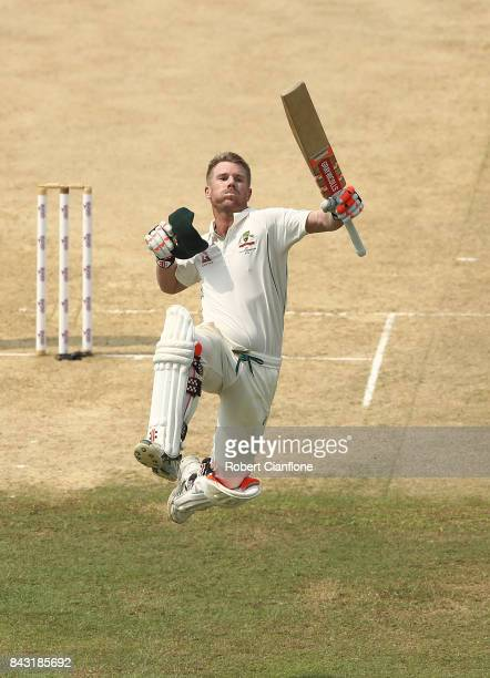 David Warner of Australia celebrates after scoring his century during day three of the Second Test match between Bangladesh and Australia at Zahur...