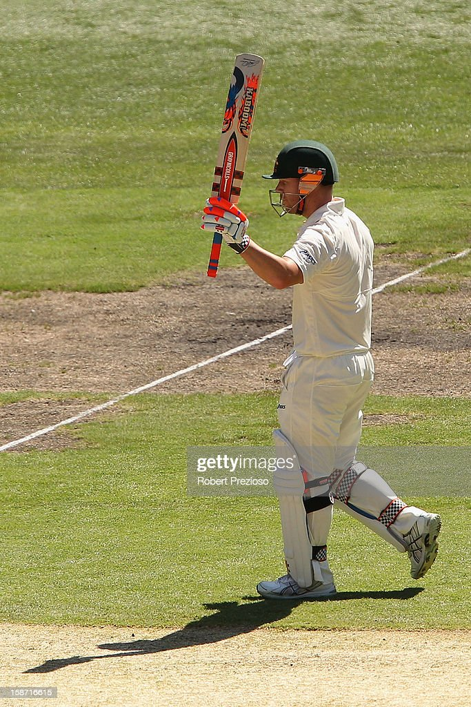 David Warner of Australia celebrates after scoring his half century during day one of the Second Test match between Australia and Sri Lanka at Melbourne Cricket Ground on December 26, 2012 in Melbourne, Australia.