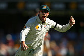 David Warner of Australia celebrates after taking a catch to dismiss Martin Guptill of New Zealand off the bowling of Josh Hazlewood of Australia...