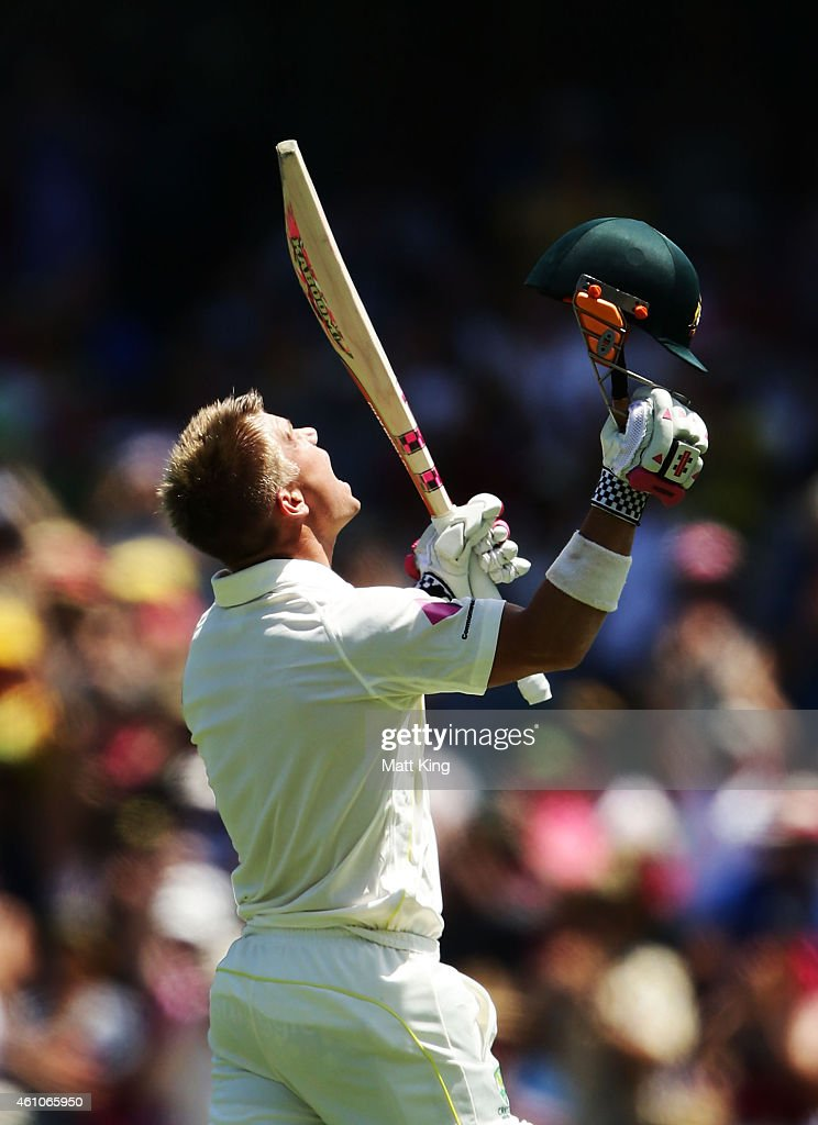 David Warner of Australia celebrates and acknowledges the crowd after scoring a century during day one of the Fourth Test match between Australia and...