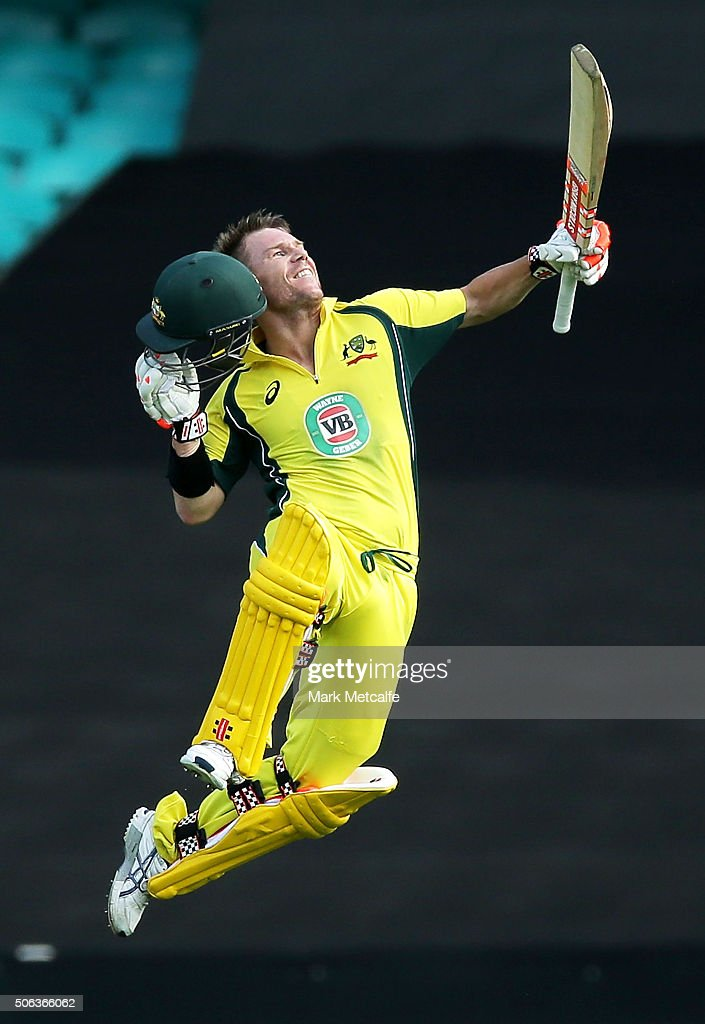 David Warner of Australia celebrates and acknowledges the crowd after scoring a century during game five of the Commonwealth Bank One Day Series match between Australia and India at Sydney Cricket Ground on January 23, 2016 in Sydney, Australia.