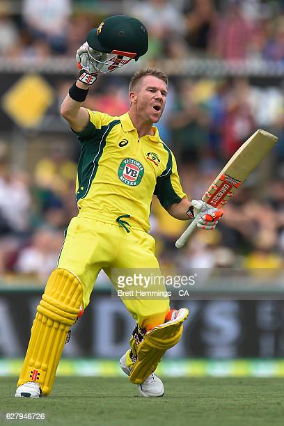 David Warner of Australia celebrates and acknowledges the crowd after scoring a century during game two of the One Day International series between...