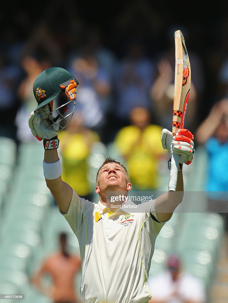 David Warner of Australia celebrates as he reaches his century during day one of the First Test match between Australia and India at Adelaide Oval on...