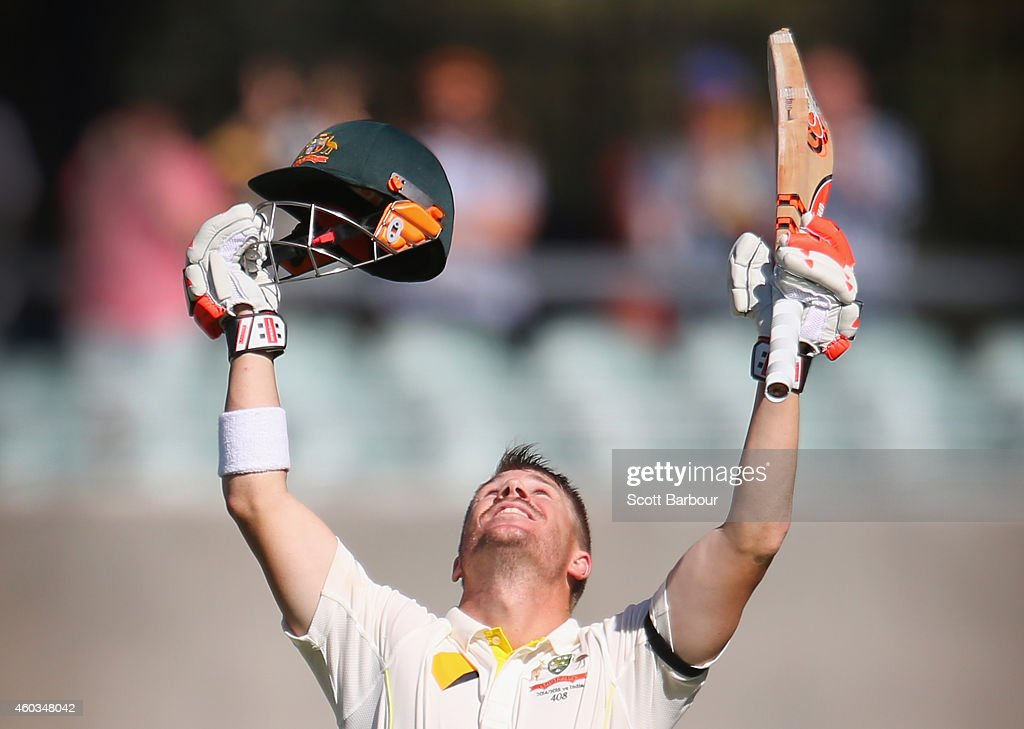 David Warner of Australia celebrates as he reaches his century during day four of the First Test match between Australia and India at the Adelaide...