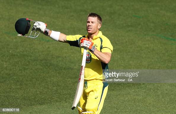 David Warner of Australia celebrates as he reaches his century during game three of the One Day International series between Australia and New...