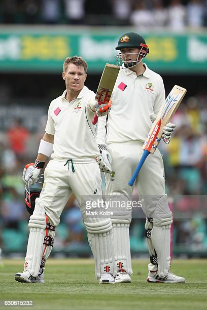 David Warner of Australia celebrates his century as Matt Renshaw of Australia watches on during day one of the Third Test match between Australia and...