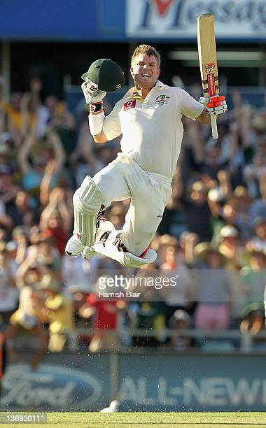 David Warner of Australia celebrates his century during day one of the third Test match between Australia and India at WACA on January 13 2012 in...
