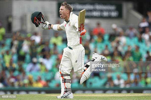 David Warner of Australia celebrates his century during day one of the Third Test match between Australia and Pakistan at Sydney Cricket Ground on...