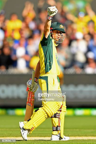 David Warner of Australia celebrates making 150 during game three of the One Day International series between Australia and New Zealand at Melbourne...
