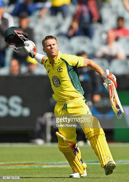 David Warner of Australia celebrates making a century during game three of the One Day International series between Australia and New Zealand at...