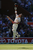 David Warner of Australia celebrates making his century during day four of the First Test match between Australia and India at Adelaide Oval on...