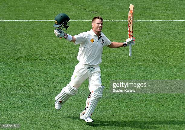 David Warner of Australia celebrates scoring a century during day one of the First Test match between Australia and New Zealand at The Gabba on...