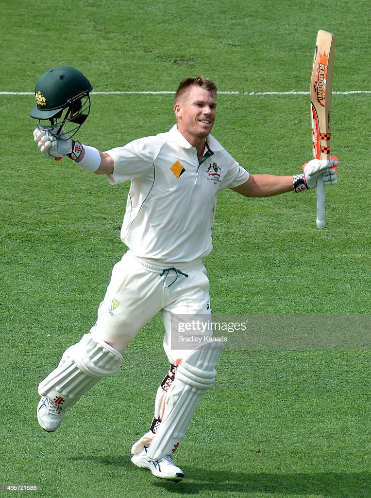 <a gi-track='captionPersonalityLinkClicked' href=/galleries/search?phrase=David+Warner+-+Cricketer&family=editorial&specificpeople=4262255 ng-click='$event.stopPropagation()'>David Warner</a> of Australia celebrates scoring a century during day one of the First Test match between Australia and New Zealand at The Gabba on November 5, 2015 in Brisbane, Australia.