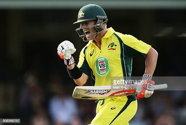 David Warner of Australia celebrates scoring a century during game five of the Commonwealth Bank One Day Series match between Australia and India at...