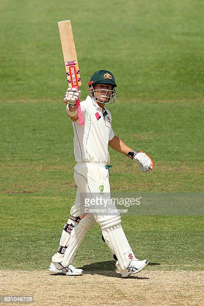 David Warner of Australia celebrates scoring a half century during day four of the Third Test match between Australia and Pakistan at Sydney Cricket...