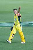 David Warner of Australia celebrates scoring his century during game five of the Commonwealth Bank One Day Series match between Australia and India...