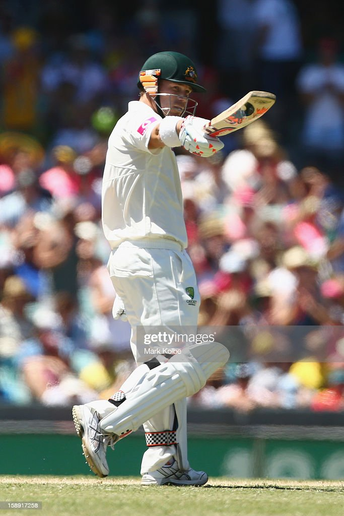 David Warner of Australia celebrates scoring his half century during day two of the Third Test match between Australia and Sri Lanka at Sydney Cricket Ground on January 4, 2013 in Sydney, Australia.
