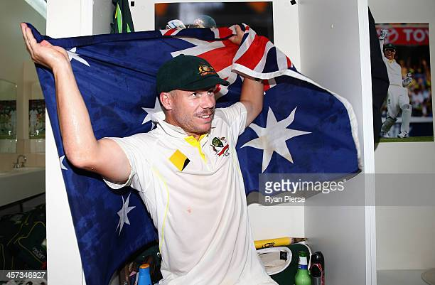 David Warner of Australia celebrates victory in the change rooms during day five of the Third Ashes Test Match between Australia and England at WACA...
