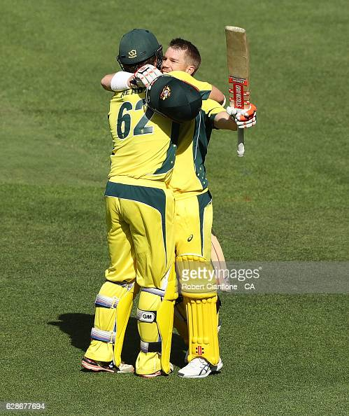 David Warner of Australia celebrates with Travis Head of Australia after reaching his century during game three of the One Day International series...