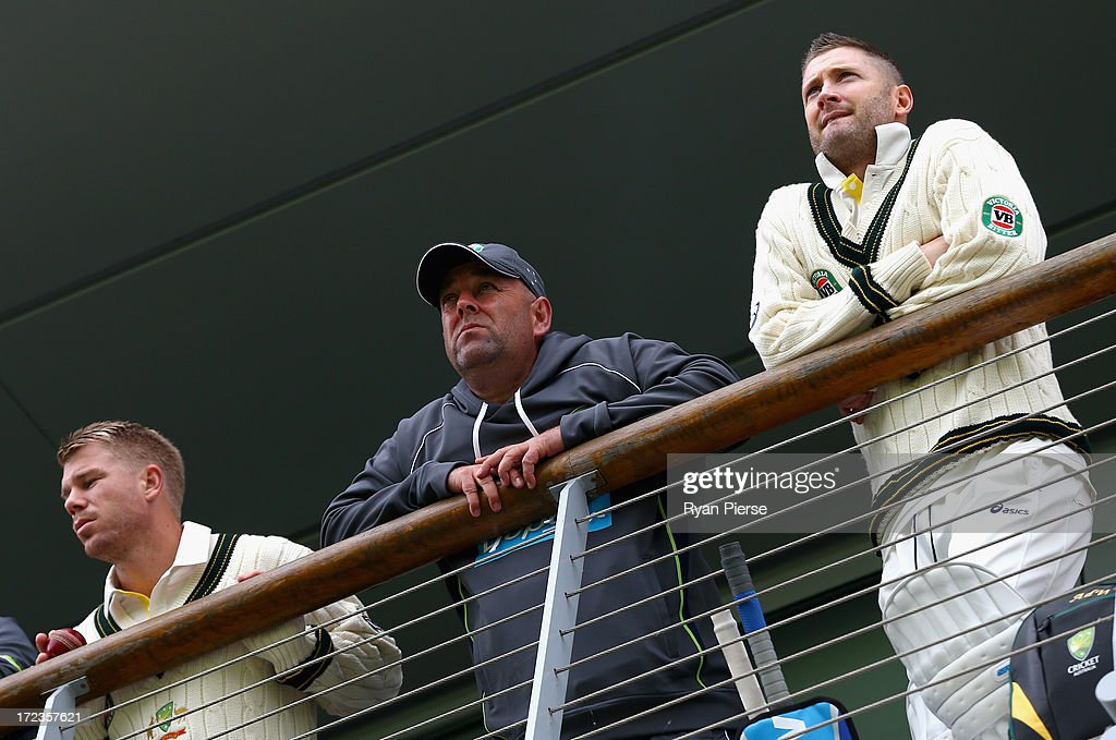 David Warner of Australia, <a gi-track='captionPersonalityLinkClicked' href=/galleries/search?phrase=Darren+Lehmann+-+Cricket+Player&family=editorial&specificpeople=171311 ng-click='$event.stopPropagation()'>Darren Lehmann</a>, coach of Australia, and Michael Clarke of Australia look on during day one of the Tour Match between Worcestershire and Australia at New Road on July 2, 2013 in Worcester, England.