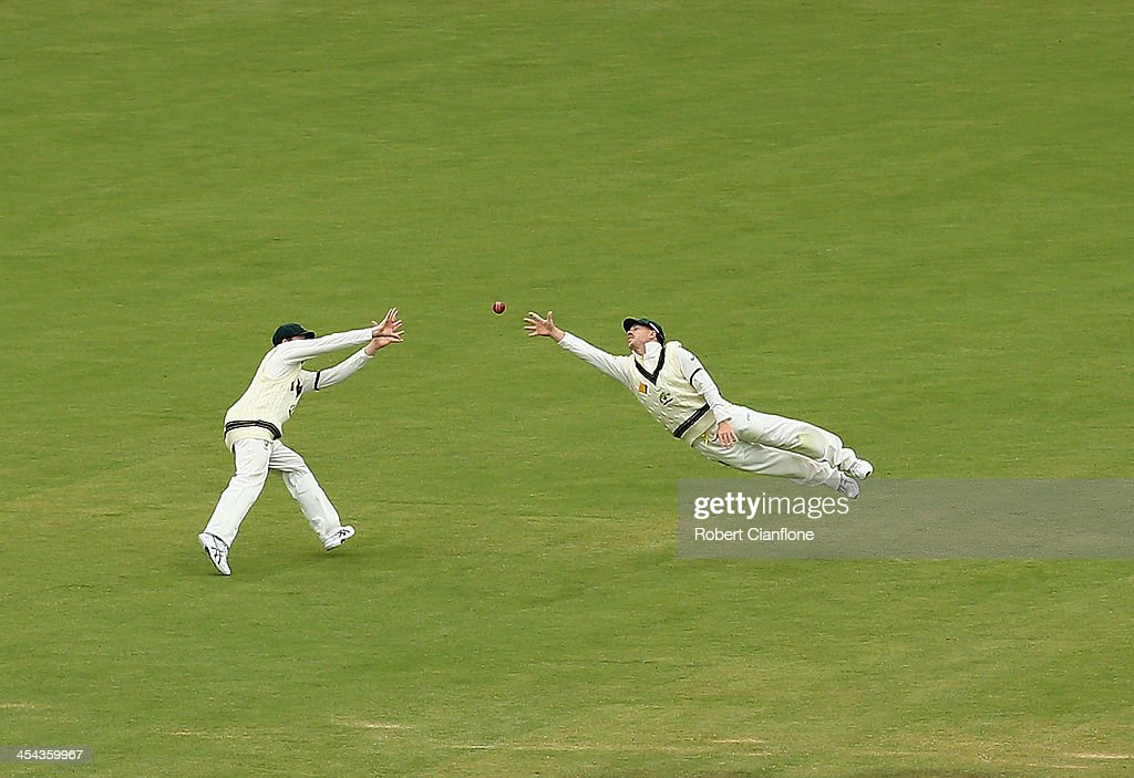 David Warner of Australia dives for a ball during day five of Second Ashes Test Match between Australia and England at Adelaide Oval on December 9, 2013 in Adelaide, Australia.