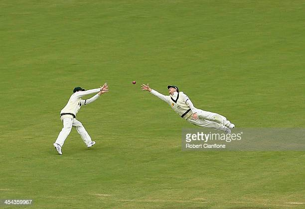 David Warner of Australia dives for a ball during day five of Second Ashes Test Match between Australia and England at Adelaide Oval on December 9...