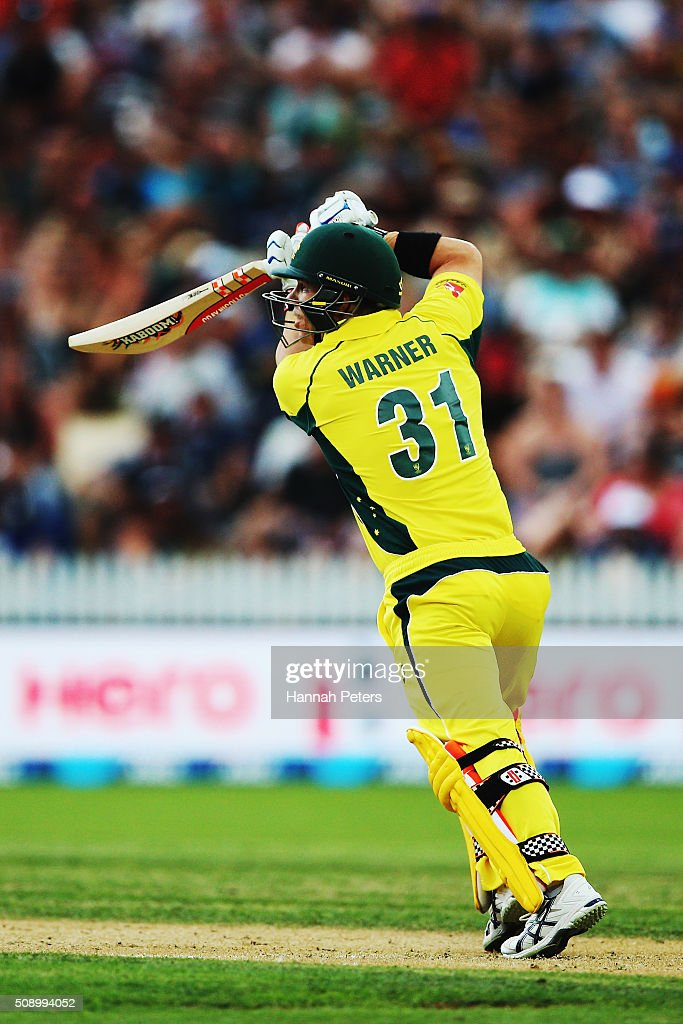 David Warner of Australia drives the ball away for four runs during the 3rd One Day International cricket match between the New Zealand Black Caps and Australia at Seddon Park on February 8, 2016 in Hamilton, New Zealand.