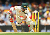 David Warner of Australia falls after keeping out a yorker bowled by Trent Boult of New Zealand during day one of the First Test match between...