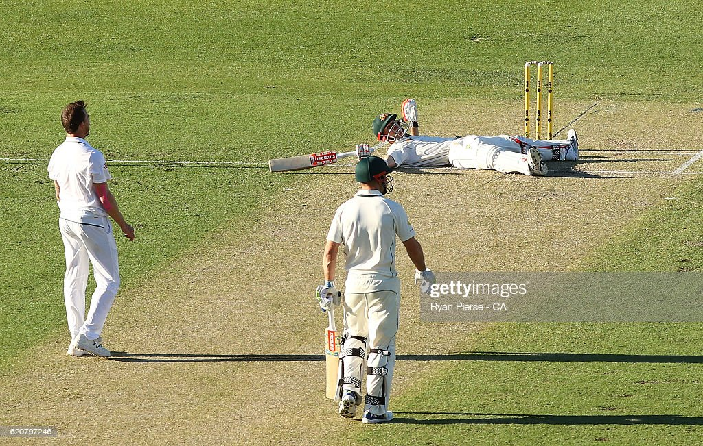 David Warner of Australia falls to the ground after hitting a six off Dale Steyn of South Africa during day one of the First Test match between Australia and South Africa at WACA on November 3, 2016 in Perth, Australia.