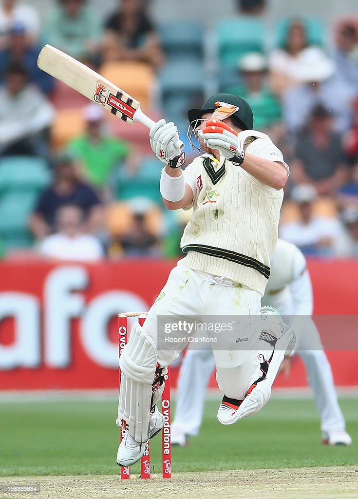 David Warner of Australia fends off a rising delivery during day one of the First Test match between Australia and Sri Lanka at Blundstone Arena on December 14, 2012 in Hobart, Australia.