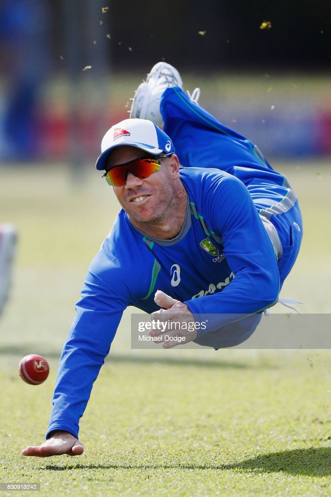 David Warner of Australia fields a ball during an Australia Test cricket squad training session at Marrara Cricket Ground on August 13, 2017 in Darwin, Australia.