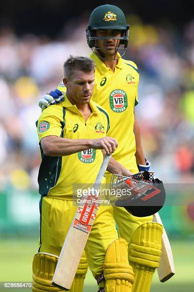David Warner of Australia gets a pat on the back from Mitchell Starc after making 156 during game three of the One Day International series between...