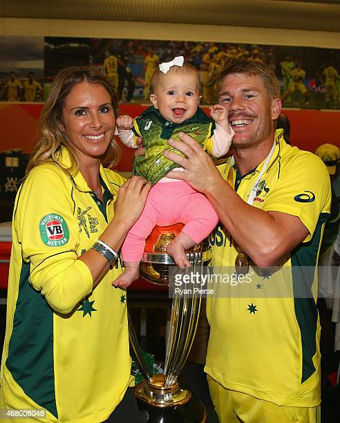 David Warner of Australia his fiance Candice Falzon and their daughter Ivy Warner pose with the trophy in the changerooms during the 2015 ICC Cricket...