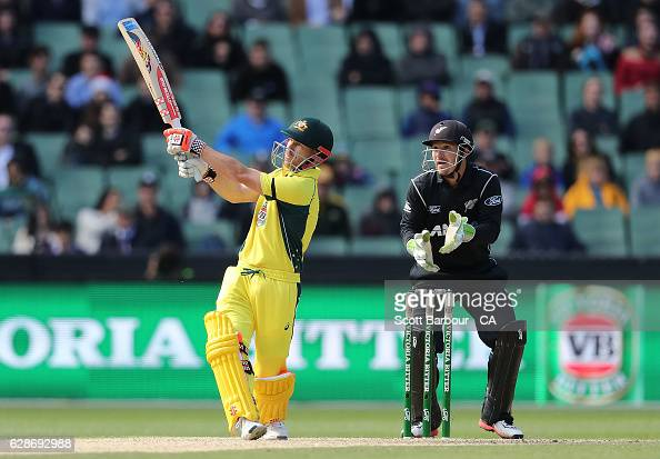 David Warner of Australia hits a six as wicketkeeper BJ Watling of New Zealand looks on during game three of the One Day International series between...