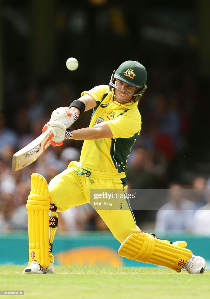 David Warner of Australia hits a six during game five of the Commonwealth Bank One Day Series match between Australia and India at Sydney Cricket...
