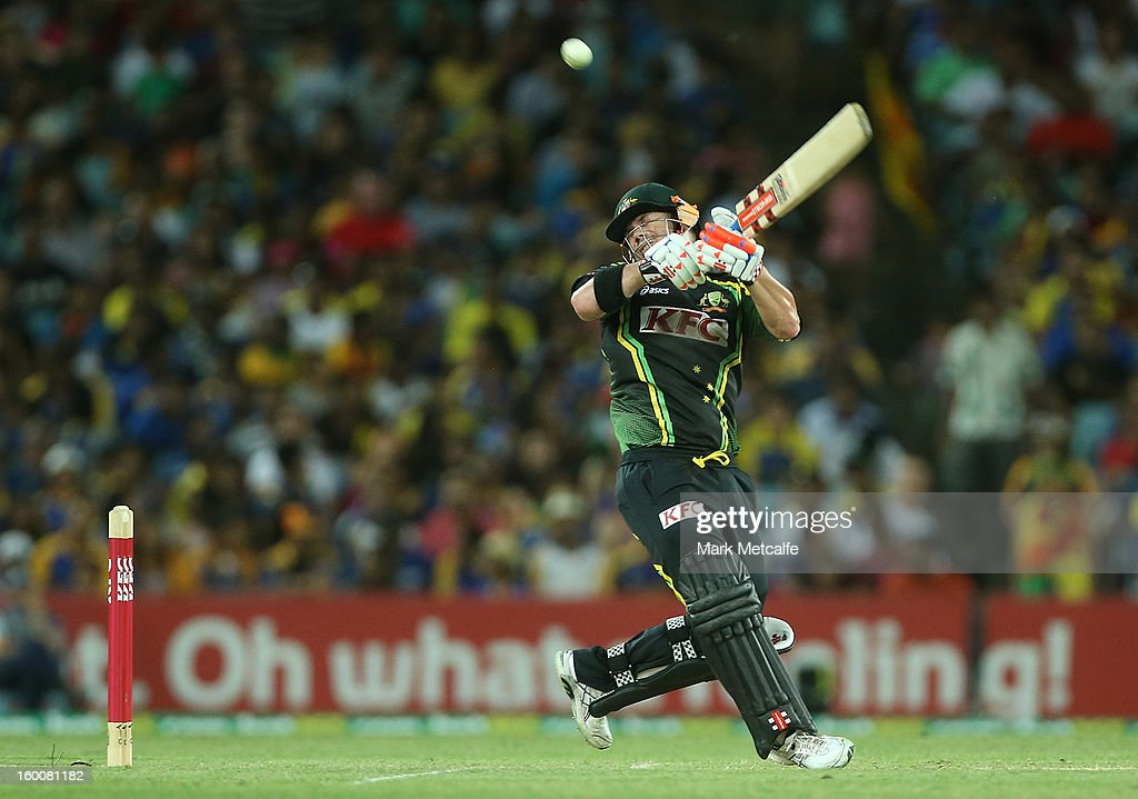 David Warner of Australia hits a six during game one of the Twenty20 international match between Australia and Sri Lanka at ANZ Stadium on January 26, 2013 in Sydney, Australia.