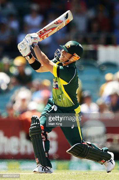 David Warner of Australia hits a six during game three of the One Day International Series between Australia and South Africa at Manuka Oval on...
