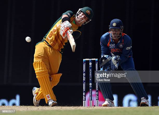 David Warner of Australia hits a six during the ICC World Twenty20 Super Eight match between Australia and India at the Kensington Oval on May 7 2010...