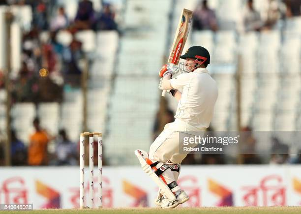 David Warner of Australia hits out during day four of the Second Test match between Bangladesh and Australia at Zahur Ahmed Chowdhury Stadium on...
