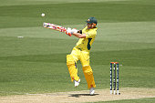 David Warner of Australia hits six runs during the ICC Cricket World Cup warm up match between Australia and India at Adelaide Oval on February 8...