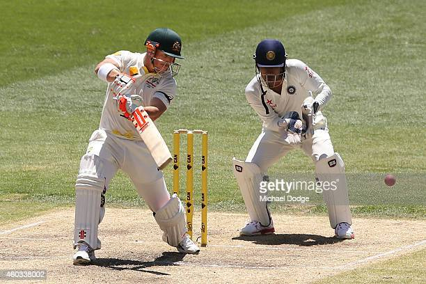 David Warner of Australia hits the ball in front of Indian keeper Wriddhiman Saha during day four of the First Test match between Australia and India...