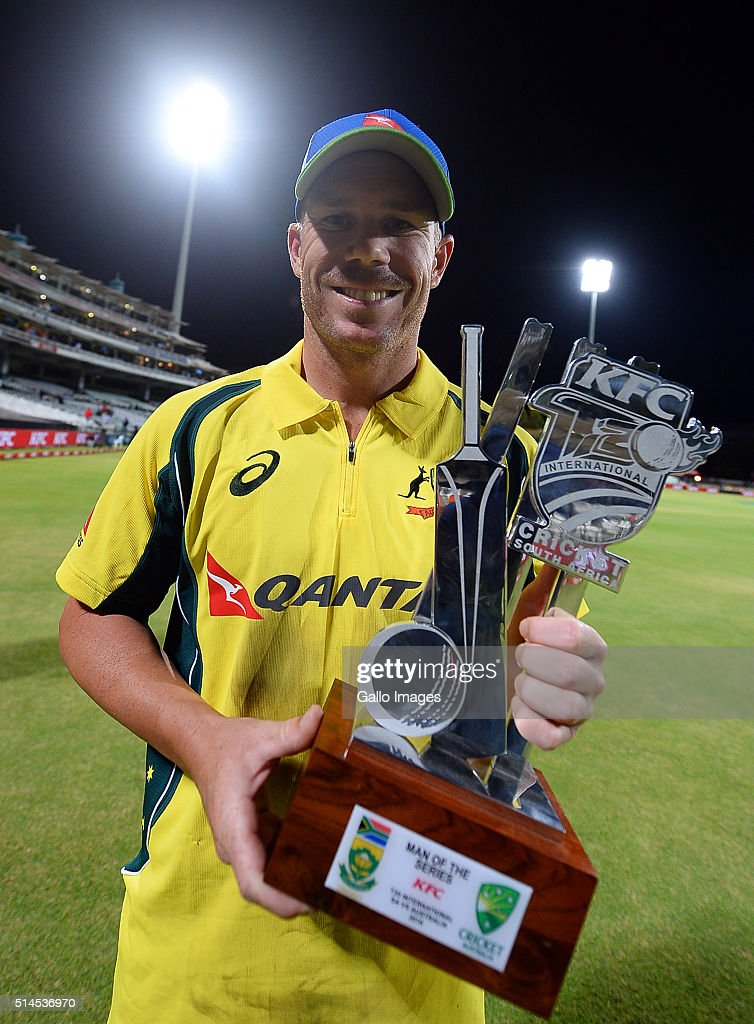 David Warner of Australia holds the man of the series trophy after winningthe 3rd KFC T20 International match between South Africa and Australia at PPC Newlands on March 09, 2016 in Cape Town, South Africa.